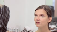 Make-up artist corrects model complexion Stock Footage