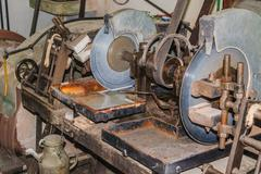 Old stone cutting machine with water cooling. Stock Photos