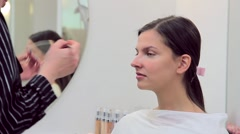 Make-up artist uses a concealer in make-up model Stock Footage