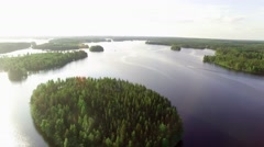 Beautiful summer Nordic lake aerial landscape with motorboat driving on the calm Stock Footage
