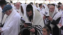 Jews pray in the Western Wall after Priestly Blessing Stock Footage