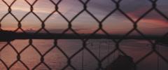 Skyline Through Chain Link Fence Stock Footage