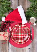 Overhead view of a festive Christmas dinner setting with red berry decoration Stock Photos
