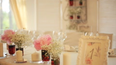 Wedding table at a wedding feast decorated with bridal bouquet Stock Footage
