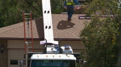 Contractor delivers roofing supplies to residential suburban home. Stock Footage