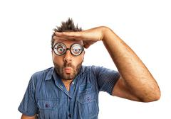 Man with funny expression and thick glasses looking far away. Stock Photos