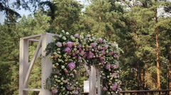 Wedding arch decorated with flowers Stock Footage