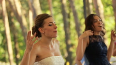 Happy bride and guests are dancing Stock Footage