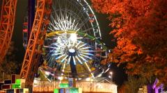Ferris wheel in an amusement Park in festive lights in action. Stock Footage