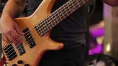 Stylish guitarist playing on a stage with a band on wedding reception with cool Stock Footage