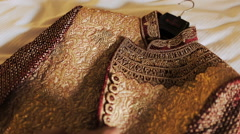 Indian groom takes on his wedding suit Stock Footage