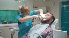 Female dentist extracting patient's tooth. Steadicam. Stock Footage
