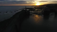 Fast and low aerial view towards Watchet lighthouse. Stock Footage