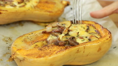 Baked squash with olive oil and date honey, stuffed with mushrooms and cheese. Stock Footage