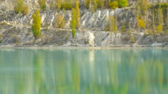 Reflection of green poplars on lake surface Stock Footage