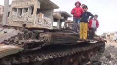 Syria - February 23, 2016: Children standing on tank, ISIS war, war news Stock Footage