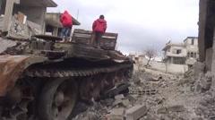 Syria - February 23, 2016: Children on tank, ISIS war, war news Stock Footage