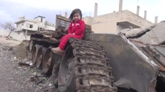 Syria - February 23, 2016: Children on tank, ISIS war, war news Stock Footage