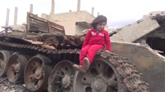 October 19, 2016: Small girl on tank, Syria Stock Footage