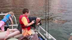Family catching fish on a boat, slow HD  Stock Footage