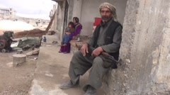 October 19, 2016: Old man with kalashnikov and family speaking, ISIS war, Syria Stock Footage