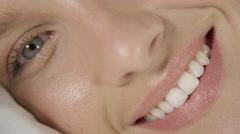 CLOSE UP DOF: Naturally beautiful Caucasian girl sleeping, waking up and smiling Stock Footage
