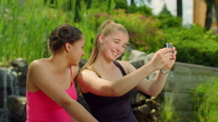 Two girls grimacing when taking photo with phone. Self portrait Stock Footage