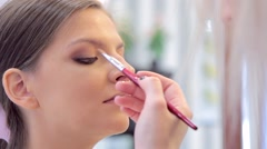 Professional make-up is being done by make-up artist Stock Footage