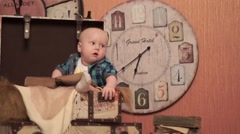 Child on the background of the big clock Stock Footage