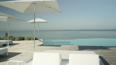 CLOSE UP: View of amazing high class pool lounge club in beach oceanfront hotel Stock Footage