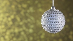 Silver Christmas ball diamond on a gold sparkling background. Stock Footage