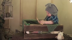 Child and owlet in a box Stock Footage