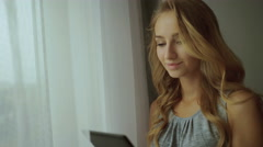 Pretty blond lady using tablet Stock Footage