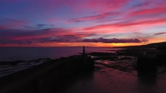Panning reveal of Watchet harbour area just before sunrise. Stock Footage