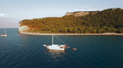 Aerial View of Ship Which Tows a Boat in Sea Bay Stock Footage