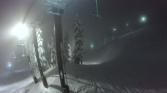 Aerial Shot Ski Resort Chair Lift at Night Winter Snow Stock Footage