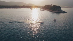 Aerial View of Swimming Boat in Sea Bay on Sunset Stock Footage