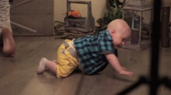 Little boy crawling on the floor Stock Footage