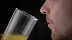 Man drink Effervescent vitamin C tablet bubbles in glass of water. Pill in slow Stock Footage