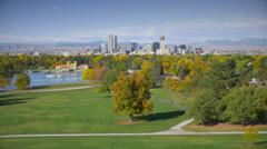 Pan across Denver Skyline with Autumn Trees Stock Footage