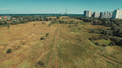 Flying Over Field in Direction of Power Station Stock Footage