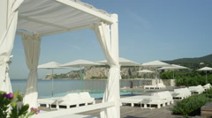 CLOSE UP: White shade pavilion for newlyweds on beautiful hotel beach Stock Footage