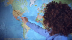4K Teacher or Student Woman with Curly Hair Teaching Geography on Map Stock Footage