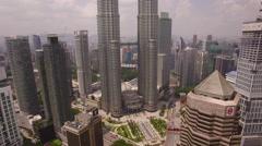 Kuala Lumpur skyline view flying back Stock Footage