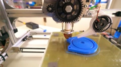 3D printer with blue filament Stock Footage