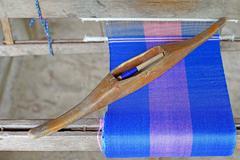 Wooden bobbin on ancient silk loom Stock Photos