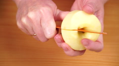 Woman hands peeled apple fruit from seeds 4K Stock Footage