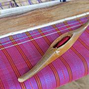 Wooden bobbin on ancient silk loom Stock Photos