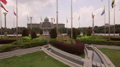 Rising over flags Presidential Palace of Putrajaya Stock Footage