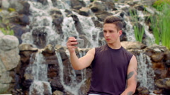 Young man taking selfie. Serious expression on man face. Man selfie Stock Footage